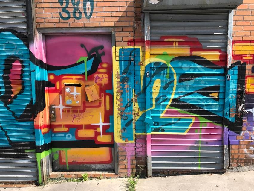 a graffiti covered door in Bushwick Brooklyn & The Arts Adventurer | Street art and graffiti | Art-covered doors in ...